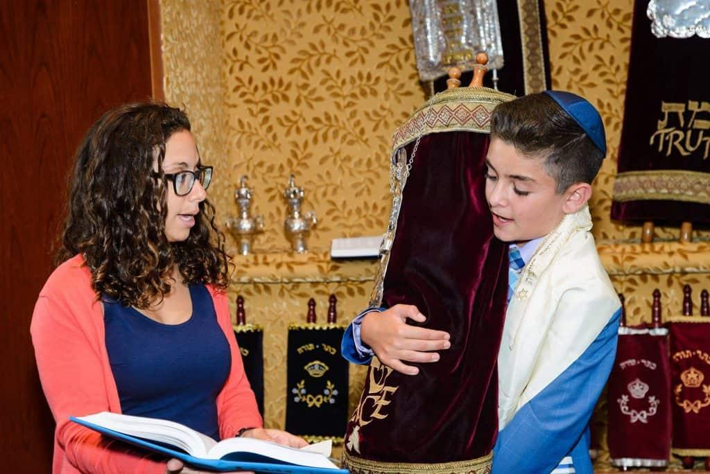 Rabbi Rachel Ackerman with Bar Mitzvah student with Torah