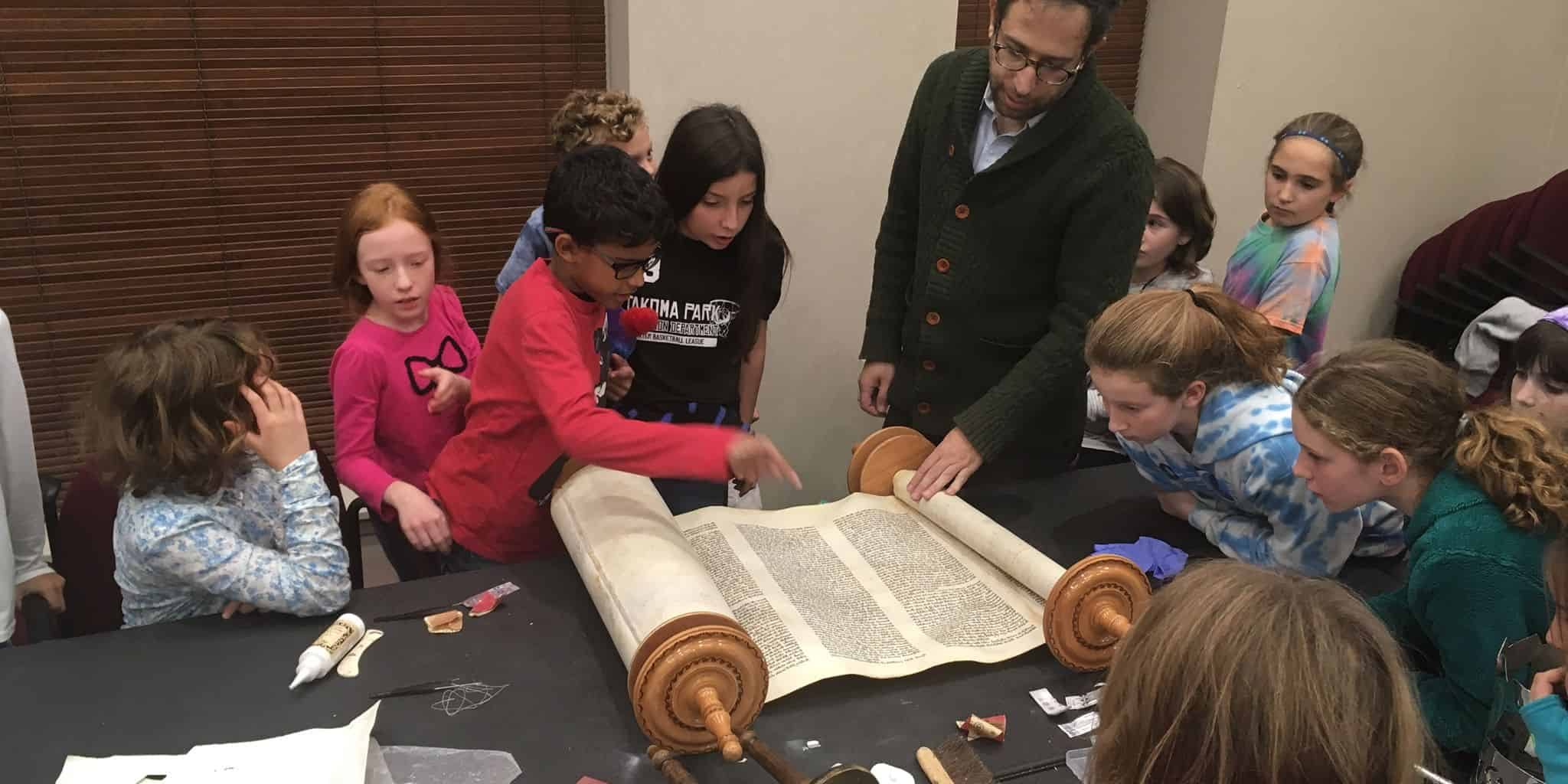 Religious School students meeting with Torah scribe